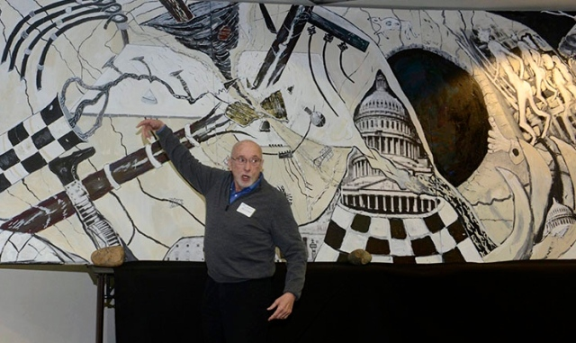 Michael Speaking at USGS event with his painting 'Gone with the Wind is the Electric Grid'